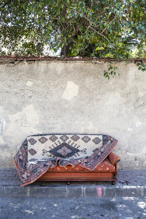 Old carpet on sofa bed Stock Photo