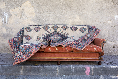 lovelorn: Old carpet on sofa bed Stock Photo