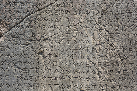 inscribed: Macro view of script on Inscribed Pillar in Xanthos Ancient City, Antalya, Turkey