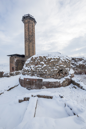 The Mosque Ef Ebul Manucehr and the tomb the mosque Manucehr, Ani Ulu Mosque in Ani ancient city, Kars, Turkey. Ani is a ruined medieval Armenian city now situated in the Turkeys province of Kars and next to the closed border with Armenia. Ani is a  UNE Stock Photo