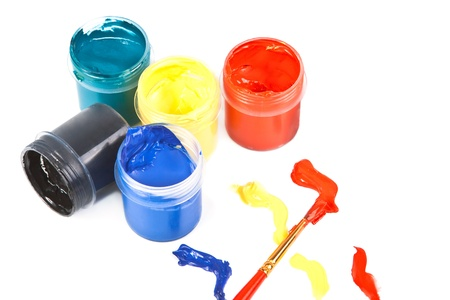 Several open jars with bright colors on a white background. photo