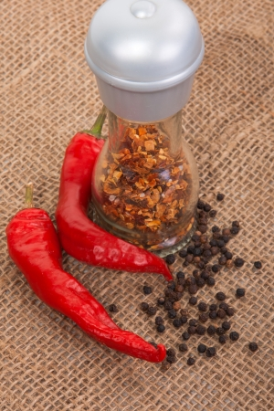 premise: Several types of peppers on the premise of burlap