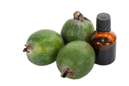 iodine: Several feijoa and a bottle of iodine in isolation on white background  Stock Photo