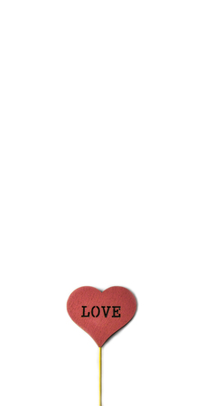 Red wooden heart on the white background with copy space. Love concept Standard-Bild - 121337020