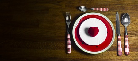 Valentines day dinner with table setting on wooden background with copy space Standard-Bild - 121337040