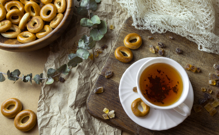 Russian traditional sweets dry bakery bagels and white cup of tea Standard-Bild - 121337518