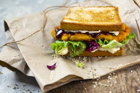 Katsu Sando - food trend japanese sandwich with chicken cutlet, cabbage and tonkatsu sauce. Japanese cuisine Standard-Bild - 121337427