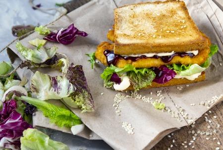 Katsu Sando - food trend japanese sandwich with chicken cutlet, lettuce leaves and tonkatsu sauce. Japanese cuisine Standard-Bild - 121337429