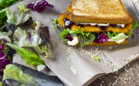 Katsu Sando - food trend japanese sandwich with chicken cutlet, lettuce leaves and tonkatsu sauce. Japanese cuisine Standard-Bild - 121337430