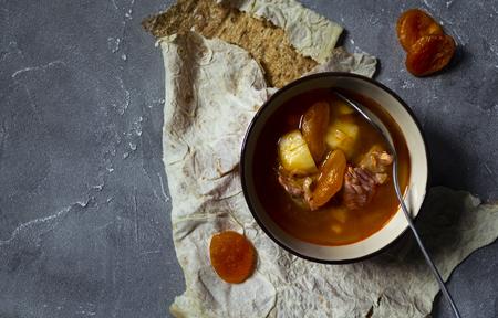 Armenian cuisine. Lavash bread and Yajni - beef soup with dried apricot Standard-Bild - 121337499