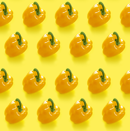Seamless pattern with yellow peppers on yellow background. monochrome concept Standard-Bild - 121337577