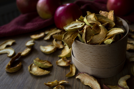 Homemade dried apples and fresh ripe apples on wooden table Standard-Bild - 123431228