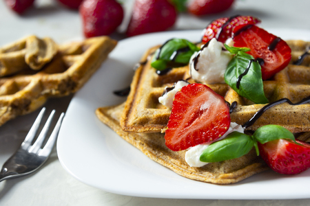 Belgium waffles dessert with strawberries, ricotta cheese and chocolate. Selective focus. Standard-Bild - 126843701