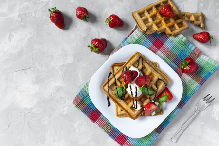 Homemade waffles with strawberries, ricotta cheese and chocolate on white plate. Flat lay, copy space Standard-Bild - 126843702