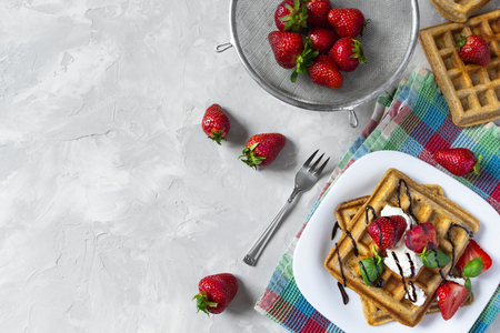 Homemade waffles with strawberries, ricotta cheese and chocolate on white plate. Flat lay, copy space Standard-Bild - 126843703