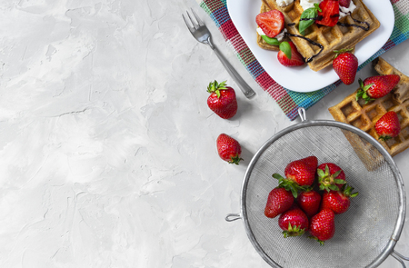 Homemade waffles with strawberries, ricotta cheese and chocolate on white plate. Flat lay, copy space Standard-Bild - 126843704