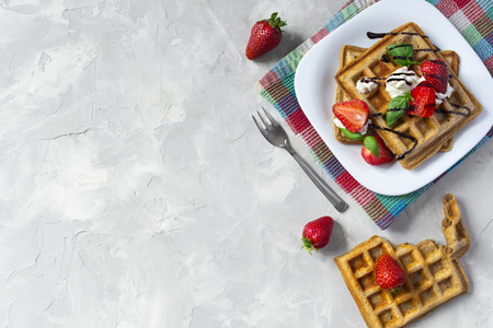 Homemade waffles with strawberries, ricotta cheese and chocolate on white plate. Flat lay, copy space Standard-Bild - 126843705