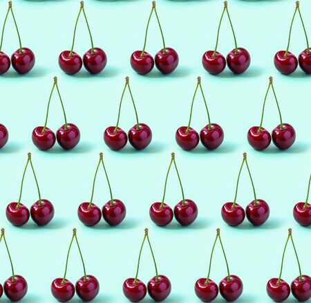 Red Cherries pattern on a turquoise background Standard-Bild - 126843796