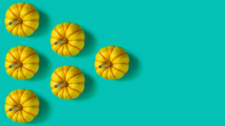 Geometric pattern with pumpkins on a pastel green background. Copy space Stock Photo