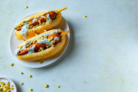 Hot dog with carrots on white plate. vegetarian fast food
