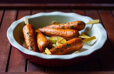 Baked carrots. vegetarian food concept