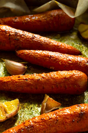 Baked carrots on Wax Paper close-up.