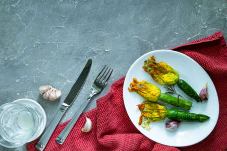Fried Zucchini Flowers Stuffed with cream cheese with garlic. Copy space Archivio Fotografico