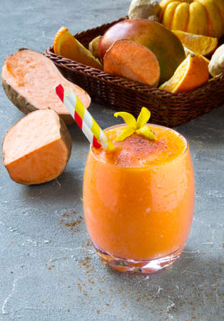 Sweet Potato Smoothie coctail with orange, Cinnamon and ginger. Vitamin, healthy food concept. Copy space Archivio Fotografico