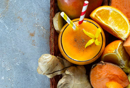 Sweet Potato Smoothie coctail with orange, mango, Cinnamon and ginger. Vitamin, healthy food concept. Copy space, flat lay Archivio Fotografico