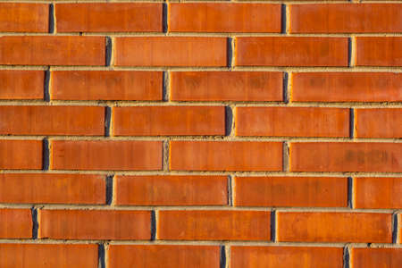 brick red wall. background of a old brick house. Archivio Fotografico
