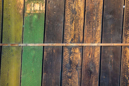 Old brown and green painted wood plank texture background Archivio Fotografico