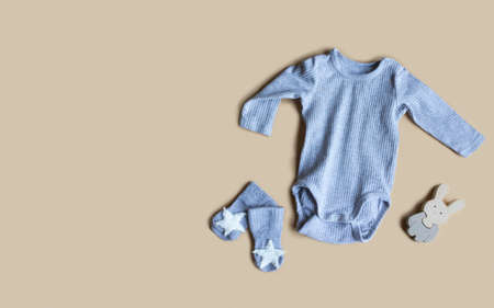 Composition with baby accessories on beige background. Unisex neutral theme. flat lay and top view. Copy space