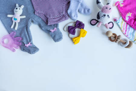 Composition with baby accessories on white background. Girls neutral theme. flat lay and top view. Copy space