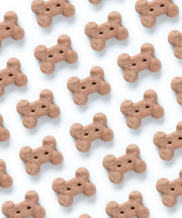 Delicious of dog biscuit on the white background pattern
