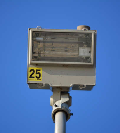photocell: A high pressure sodium light fixture with photocell high on a pole