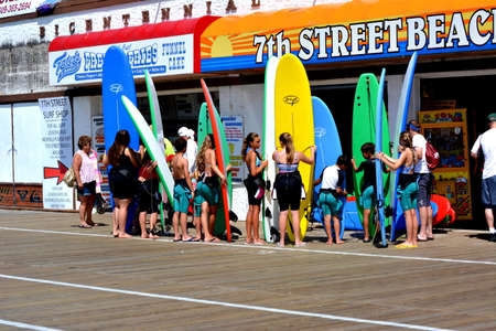 OCEAN CITY, NJ USA-628: A class of children get ready on the boardwalk for surfing class in Ocean city, NJ USA on 628.