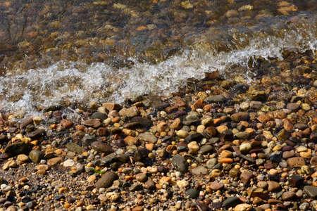 shorelines: Small Wave Crashing Rocky Shoreline