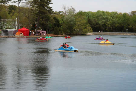 SMITHVILLE, NEW JERSEY USA  MAY 14, 2016: Paddle boats in the lake for fun and exercise.