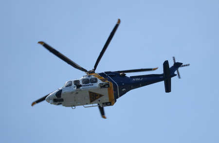 police state: ATLANTIC CITY. NJ USA JUNE 26, 2016 A state police helicopter circling the marina. Editorial