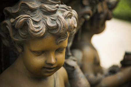 haired: Bronze Statue of the face of a curly haired child