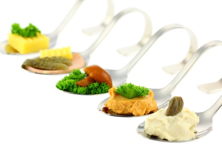 Different canapes. Shallow depth of field. Isolated on white background.