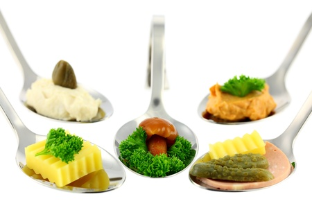 Different canapes. Focus on the mushroom. Shallow depth of field. Isolated on white background