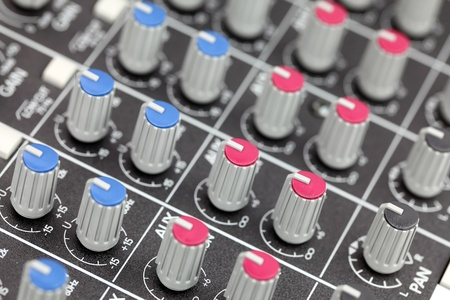 Closeup of audio mixing console. Shallow depth of field.  photo