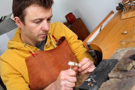Goldsmith in workshop. Making of jewelery. Handmade.  Stock Photo