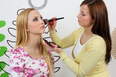 Professional makeup artist applying blusher. Stock Photo - 8965326