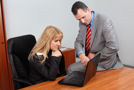 Businessman and businesswoman in the office analyze the revenue. photo