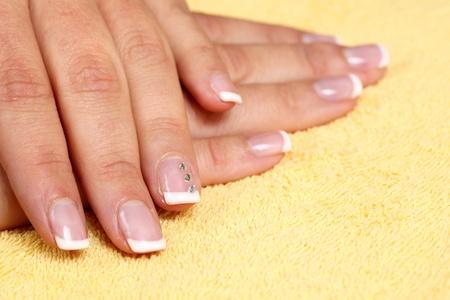 Fingernails manicure.  photo