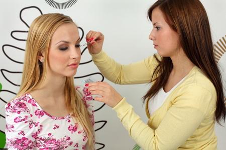 Insertion of false eyelashes. Stock Photo - 8965345