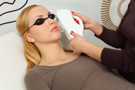 Laser hair removal in professional studio.  Stock Photo - 8965271