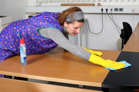 professional cleaning lady at her work in the office  photo
